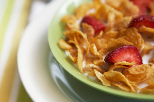 Become A Morning Eater with a bowl of corn flakes with strawberries